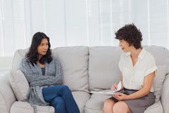 Therapist speaking to her patient Royalty Free Stock Image