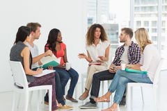 Therapist speaking to a rehab group Royalty Free Stock Images