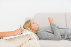 Therapist taking notes on her patient on the sofa Royalty Free Stock Photo