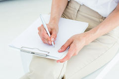 Therapist taking notes Stock Photos