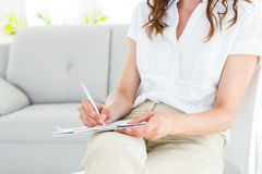 Therapist taking notes royalty free stock photography