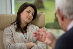 Therapist talk to his patient. Therapist talk to his young patient with depression Royalty Free Stock Image