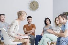 Therapist talking to man stock photo