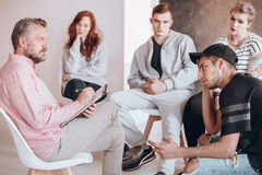 Therapist talking to teenager. Insightful therapist talking to a troubled teenager, psychotherapy concept Stock Photo