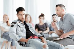 Therapist talking to teenager royalty free stock image