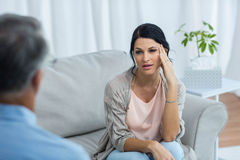 Therapist talking to worried woman Stock Photo