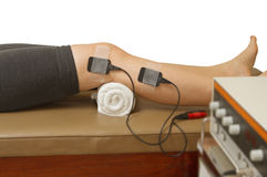 Therapist treatment patient with electrical stimulator Stock Image