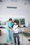 Therapist woman with boy in rehab. Woman with boy in rehab Royalty Free Stock Images