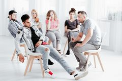 Therapist working with difficult youth. Male therapist working with difficult youth on their problems Stock Image