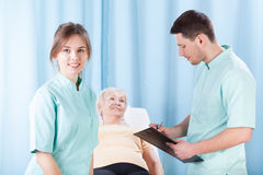 Therapists doing medical examination Royalty Free Stock Image