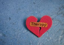 Therapy bandage on heart stock photos