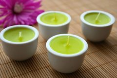 Therapy Candles. Four aromatherapy candles on a bamboo mat stock photo