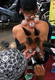 Therapy. A resident of the traditional cupping therapy with equipment from buffalo horn in Sukoharjo, Central Java, Indonesia Royalty Free Stock Photos