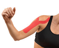 Therapy with tex tape. Injured shoulder therapy with kinesio tex tape Stock Photos