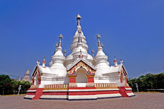 Theravada Buddhist temple. A Theravada Buddhist temple with white towers Royalty Free Stock Photo
