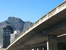 Are we there yet?. Landscape photo of a concrete overpass leading into Cape Town stock photography