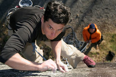 Almost there. A focused rock climber stock photo