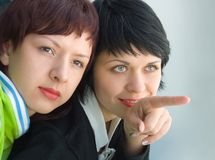 There. The girl shows the girlfriend Stock Photography