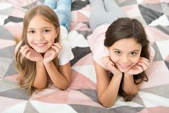 Free There Are Many Reasons To Be Happy. Happy Kids With Cute Smiles. Small Children Relax On Bed. Enjoying Happy Childhood Royalty Free Stock Photos - 165973408