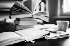 There are coffee, books, notebook and pen. Note-taking. Black and white photo Royalty Free Stock Photos