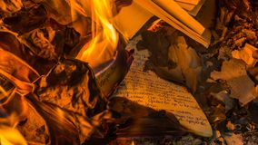 Burning old memories. There comes a time in everyone`s life, when he needs to drop off the past and continue forward. It was a hard road till this moment, but Stock Photo
