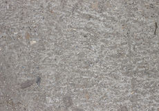 There is  a concrete background with stones Stock Images