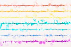 A rainbow drawn with a thin colored pens are spreading in the water. Stock Image
