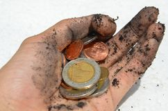 Coins in a dirty hand. royalty free stock photography