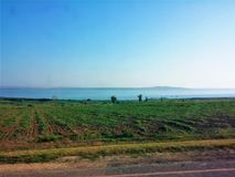 There is a firth in the distance. In the distance can be seen the estuary of the black sea and vineyard Stock Photography