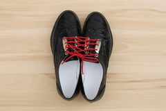 There are a gentle black shoes. Tied with red laces Stock Photography