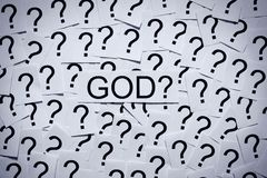 Is there a God?. Where is God? Belief? Many question marks on paper. Question concept Stock Photos