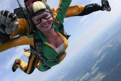 Skydiving. Tandem passenger has a big smile. stock images