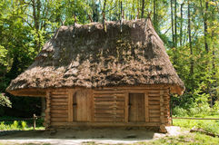 There Is An Old Wooden House In-field Stock Photo