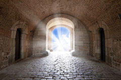 There is the light sky in the end of arch in a tunnel Royalty Free Stock Photos