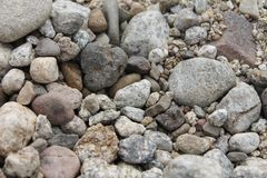 Little and Big Stones. There are little and big grey stones on the beach near the sea Royalty Free Stock Photography