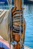 Wooden mast an gooseneck at a classic sailboat stock images