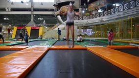 Girl jumping on a trampoline in an unusual way