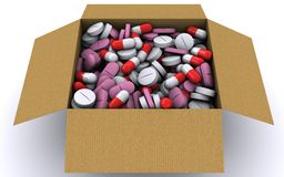 There are many different pills in a cardboard box Royalty Free Stock Photos