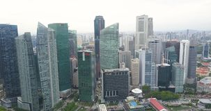 Aerial frame with hundreds of skyscrapers in downtown Singapore stock video footage