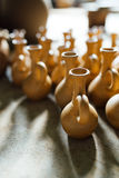 There are many  terracotta pots in the workshop Stock Images