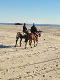 New york far rockaway mounted police officers patrol. There are mounted police officers or police officers on horses on the oceanfront area between Breeze point Stock Photos
