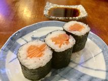 Salmon maki rolls. There are multiple types of sushi including sashimi, nigiri, and maki. Sashimi is only the meat without other ingredients such as vegetables stock photography