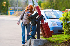 There are no barriers. A red-haired mother and her young son together lowered the barrier Stock Images