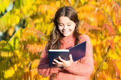 There is no end to education. Small child read book on autumn day. Small child enjoy reading on autumn landscape. Even. Little children looking at a picture stock photos
