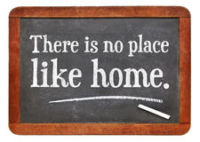 There is no place like home proverb. White chalk text on a vintage slate blackboard Royalty Free Stock Photo