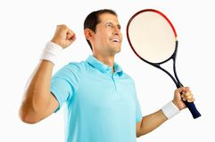 There is nothing like the feel of victory. Portrait of a young male tennis player celebrating a victory isolated on white background Royalty Free Stock Photo