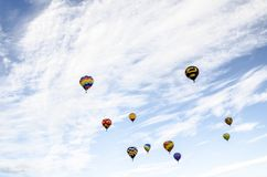 There off in the wild blue sky with the hot air balloon`s. Hot air balloon in flight Hot air balloons shaped like bees Hot air balloon shaped as the Abbey of stock images