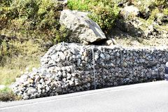 New york state mountain road stones net safety barrier. There is one of the  different  safety barrier  structure, which is  on the mountain 's road  of Royalty Free Stock Images