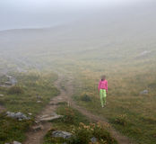 There is one girl in the fog Stock Image