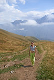 There is one girl walking in the mountains Stock Photography